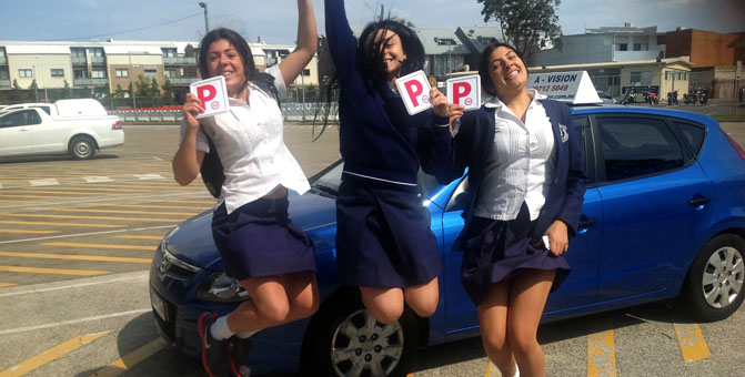 3 young school girls jump in the air in celebration